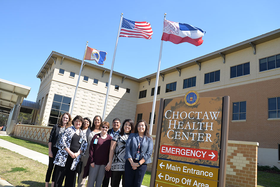 DOM representatives Fran Ingram (from left) and Margaret Wilson visit members of the Choctaw Health Center.